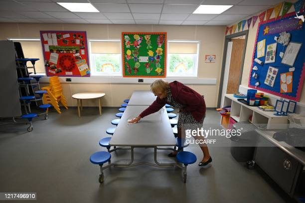 Lunchtime Supervisor Julie Machon cleans the surfaces after children finish their lunches in a teaching environment safe from Coronavirus for pupils...