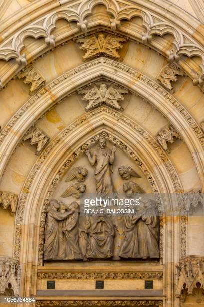 Lunette with Ascension of Christ relief of the entrance in the west front cathedral of St Vitus Prague Czech Republic
