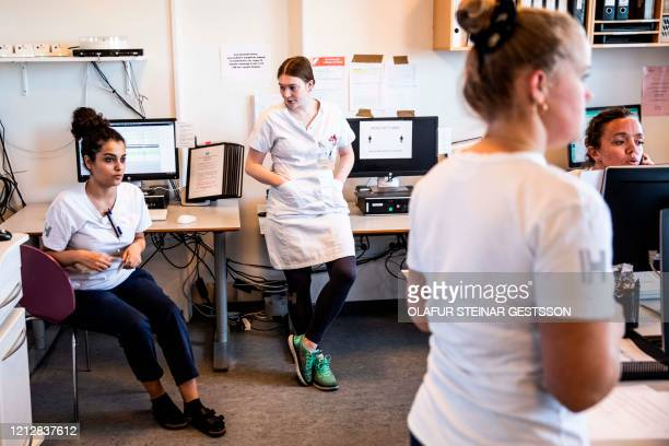 Lung Medicine staff gather in their staffroom at Bispebjerg Hospital in Copenhagen Denmark on May 7, 2020 amid the new coronavirus pandemic. /...