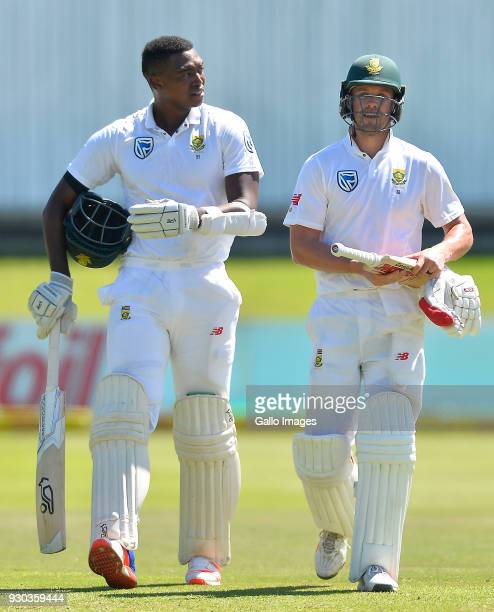 Lungi Ngidi of South Africa and AB de Villiers of South Africa walk off during day 3 of the 2nd Sunfoil Test match between South Africa and Australia...