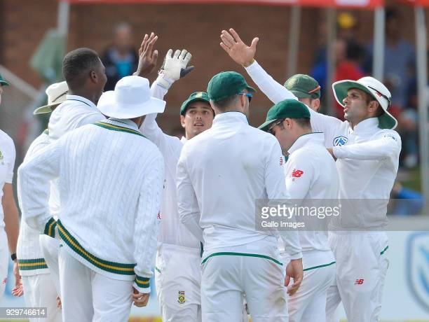 Lungi Ngidi of South Africa and team mates celebrate during day 1 of the 2nd Sunfoil Test match between South Africa and Australia at St Georges Park...