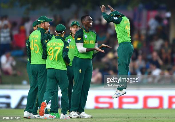 Lungi Ngidi of South Africa and Temba Bavuma of South Africa celebrate after the dismissal of Marnus Labuschagne of Australia during the 1st ODI...