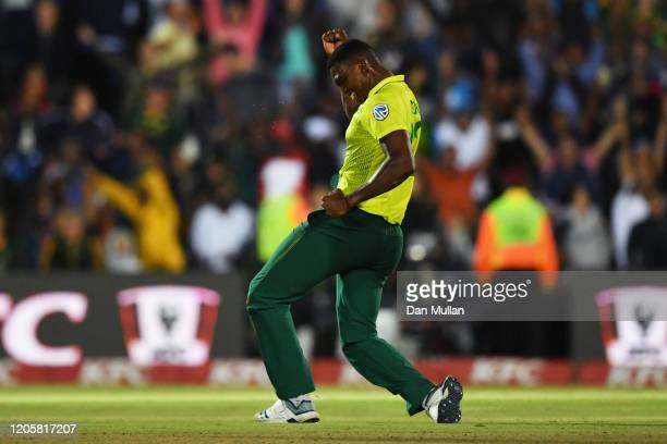 Lungi Ngidi of South Africa celebrates dismissing Moeen Ali of England during the First T20 International match between South Africa and England at...