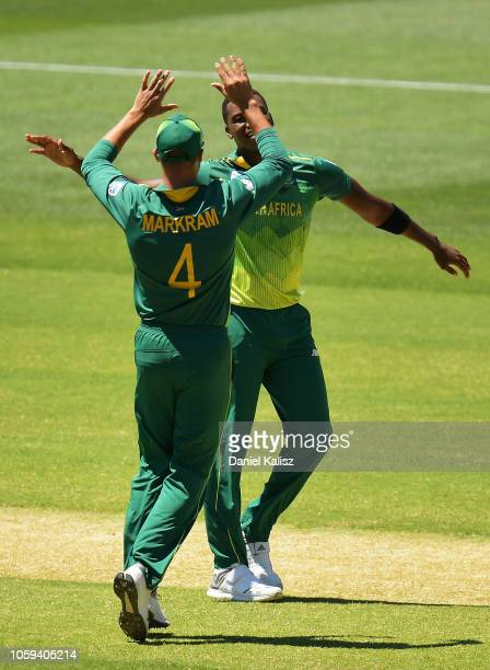 Lungi Ngidi of South Africa celebrates with Aiden Markram of South Africa after taking the wicket of Travis Head of Australia during game two of the...