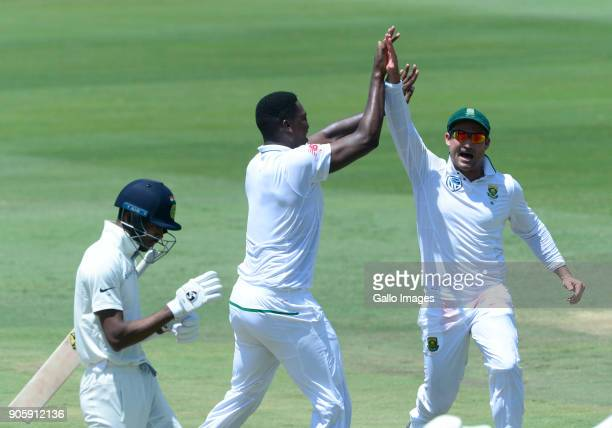 Lungi Ngidi of the Proteas celebrates the wicket of Hardik Pandya of India with Dean Elgar of the Proteas during day 5 of the 2nd Sunfoil Test match...
