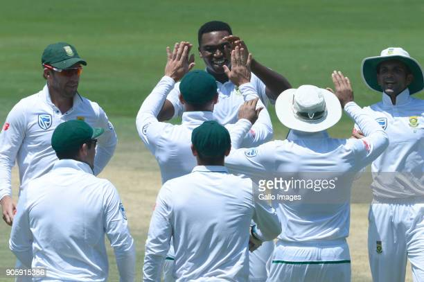 Lungi Ngidi of the Proteas celebrates the wicket of Hardik Pandya of India with his team mates during day 5 of the 2nd Sunfoil Test match between...