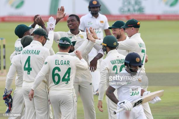 Lungi Ngidi of the Proteas celebrates the wicket of Kusal Mendisof Sri Lanka with his team mates during day 3 of the 1st Betway Test match between...