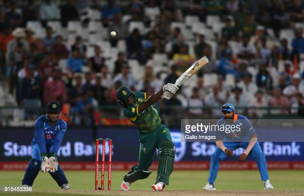 Lungisani Ngidi of South Africa hits over the top during the 3rd Momentum ODI match between South Africa and India at PPC Newlands on February 07...