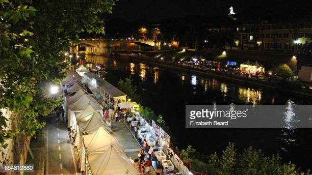 lungo il tevere festival along the banks of the tiber river in rome - film festival stock pictures, royalty-free photos & images