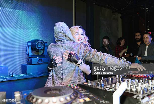 DJ Lunice hugs singer Madonna at Marquee Nightclub at The Cosmopolitan of Las Vegas as she hosts an after party for her Rebel Heart Tour concert stop...