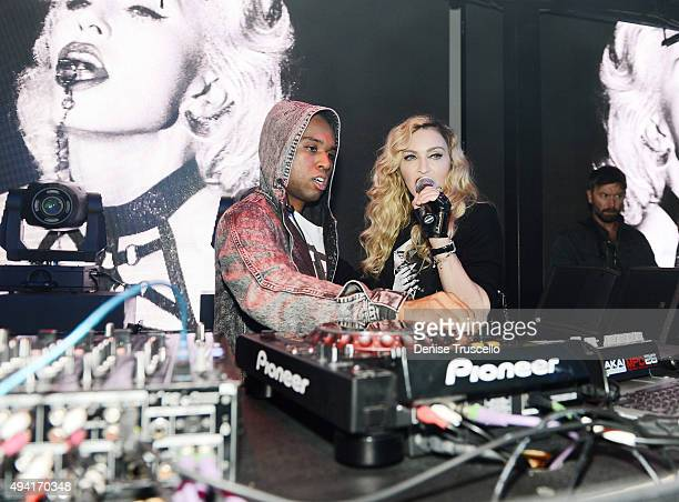 DJ Lunice performs as singer Madonna speaks at Marquee Nightclub at The Cosmopolitan of Las Vegas as Madonna hosts an after party for her Rebel Heart...