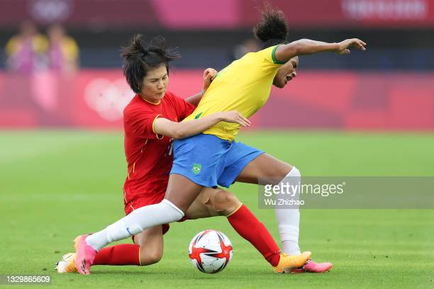 Luo Guiping of China competes for the ball in the Women's First Round Group F match between China and Brazil during the Tokyo 2020 Olympic Games at...