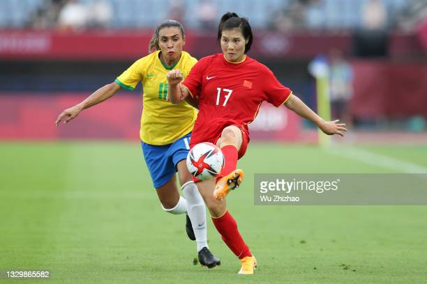Luo Guiping of China passes the ball in the Women's First Round Group F match between China and Brazil during the Tokyo 2020 Olympic Games at Miyagi...