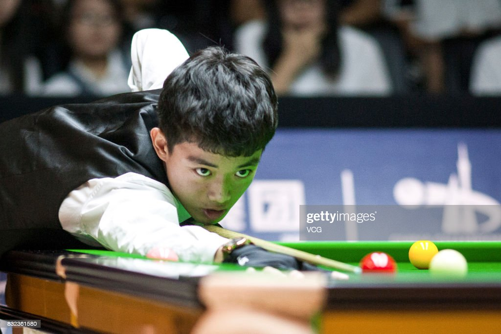 Luo Honghao of China plays a shot during a qualifying match against Mark Selby of England on day one of Evergrande 2017 World Snooker China Champion at Guangzhou Sport University on August 16, 2017 in Guangzhou, Guangdong Province of China.