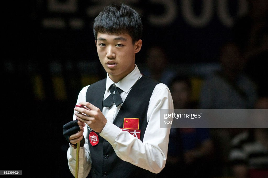 Luo Honghao of China reacts during a qualifying match against Mark Selby of England on day one of Evergrande 2017 World Snooker China Champion at Guangzhou Sport University on August 16, 2017 in Guangzhou, Guangdong Province of China.