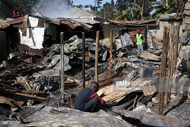 A Luo man from Mr Odinga's tribe begins building a new home on the ashes of a house destoyed by fire that belonged to a Kikuyu family in Kibera a...