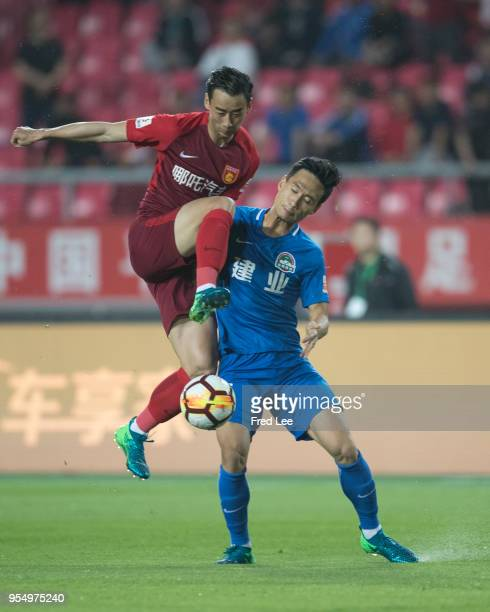 Luo Senwen of Hebei China Fortune and Chen Hao of Henan Jianye in action during 2018 Chinese Super League match between Hebei China Fortune adn Henan...