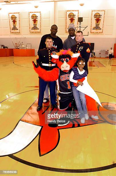 Luol Deng and Ben Wallace of the Chicago Bulls pose for a photo with United States Marines Seargent Shane Terry Corporal Brian Flynn team mascot...