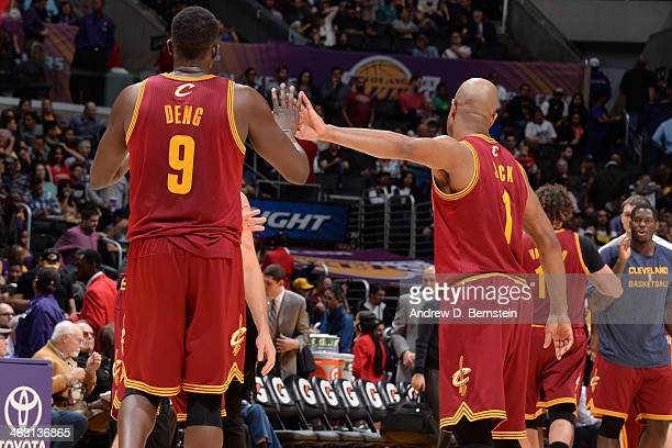 Luol Deng and Jarrett Jack of the Cleveland Cavaliers high five against the Los Angeles Lakers at Staples Center on January 14 2014 in Los Angeles...