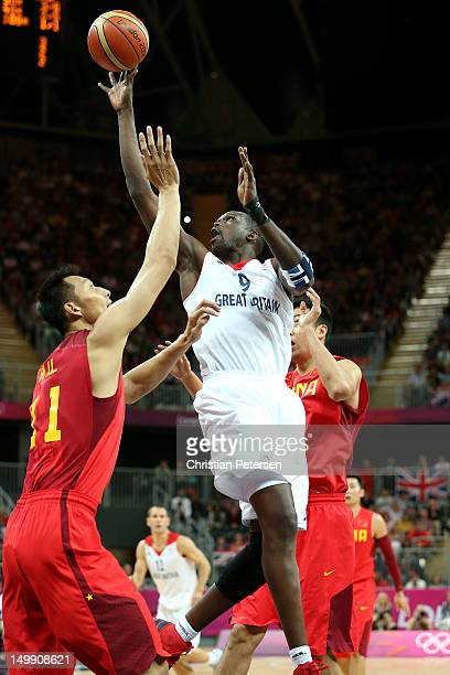 Luol Deng of Great Britain attempts a shot in the first quarter against Yi Jianlian of China during the Men's Basketball Preliminary Round match on...