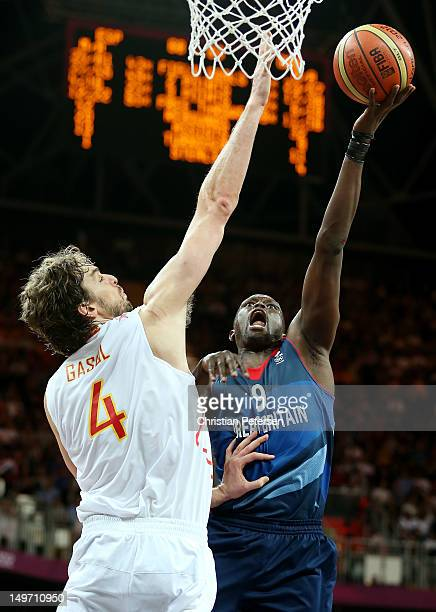 Luol Deng of Great Britain shoots against Pau Gasol of Spain in the second half during the Men's Basketball Preliminary Round match on Day 6 of the...