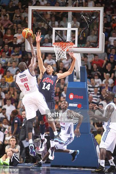 Luol Deng of Great Britian shoots against Anthony Davis of the 2012 US Men's Senior National Team during an exhibition game against Great Britain's...