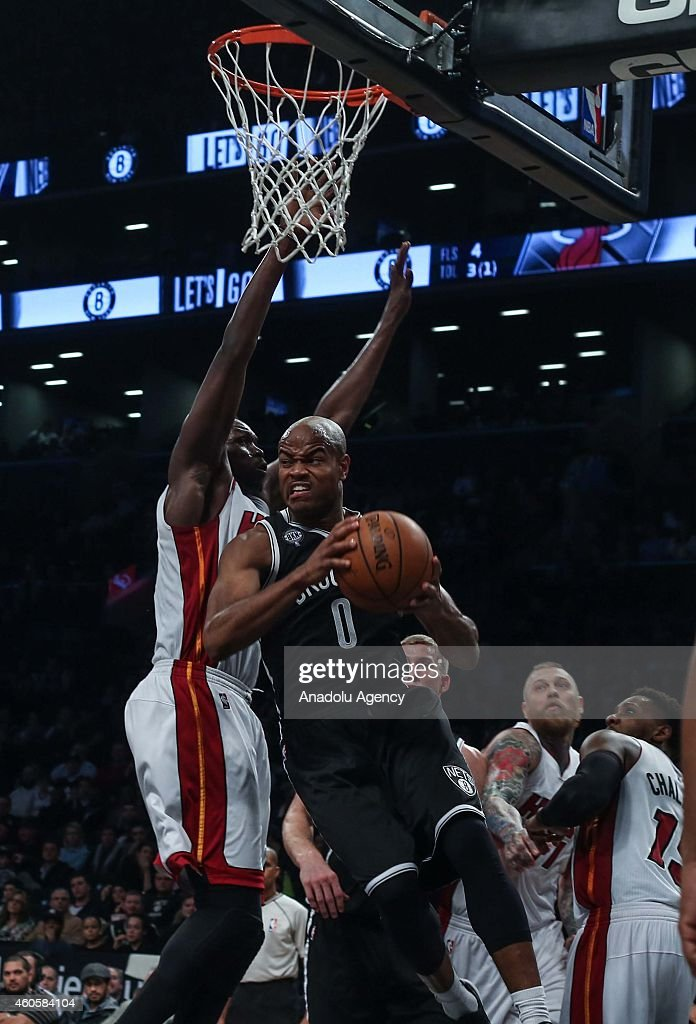 Luol Deng (L) of Miami Heat vies with Jarrett Jack #0 of Brooklyn Nets during a basketball game between Miami Heat and Brooklyn Nets at the Barclays Center on December 16, 2014 in the Brooklyn Borough of New York City.