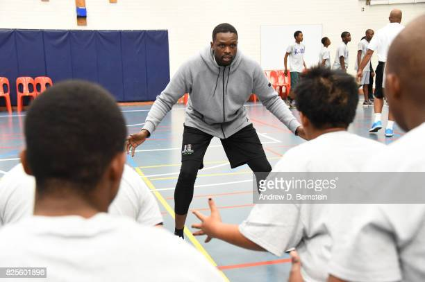 Luol Deng of Team Africa takes part in the Jr NBA Special Olympics clinic as part of Basketball Without Borders Africa at the American International...