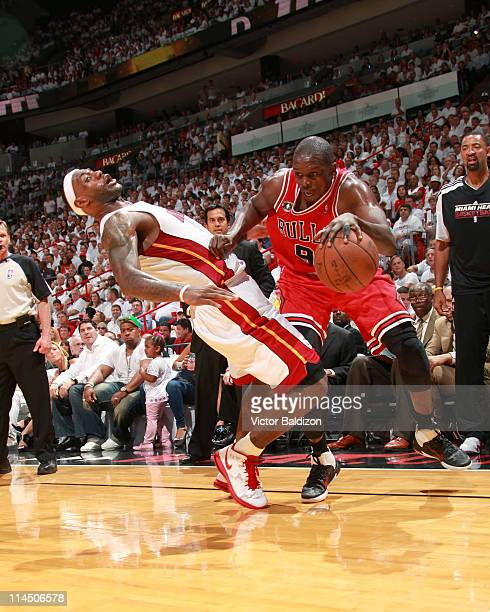 Luol Deng of the Chicago Bulls drives against LeBron James of the Miami Heat during Game Three of the Eastern Conference Finals in the 2011 NBA...