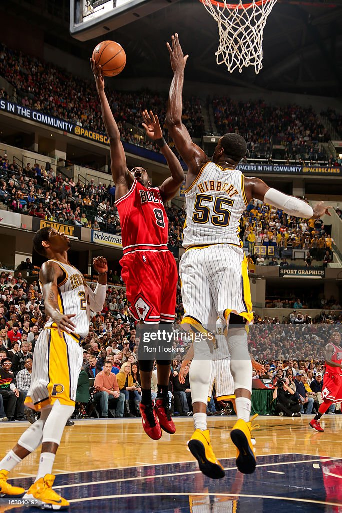 Luol Deng #9 of the Chicago Bulls drives to the basket against Roy Hibbert #55 of the Indiana Pacers on March 3, 2013 at Bankers Life Fieldhouse in Indianapolis, Indiana.