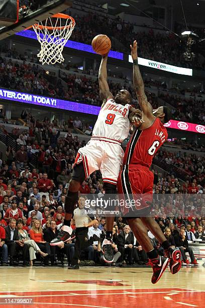 Luol Deng of the Chicago Bulls dunks against LeBron James of the Miami Heat in Game Five of the Eastern Conference Finals during the 2011 NBA...