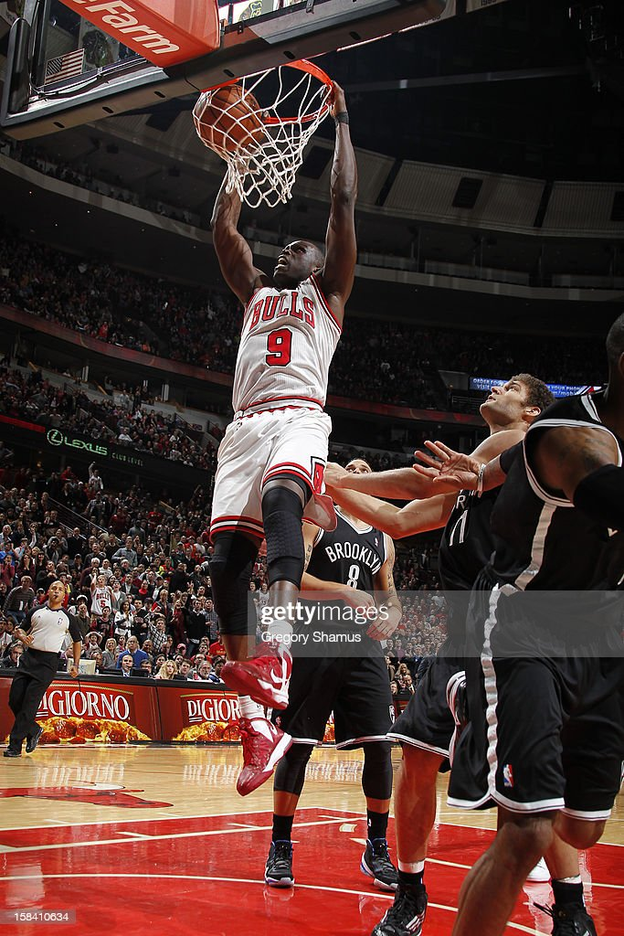 Luol Deng #9 of the Chicago Bulls dunks against the Brooklyn Nets on December 15, 2012 at the United Center in Chicago, Illinois.