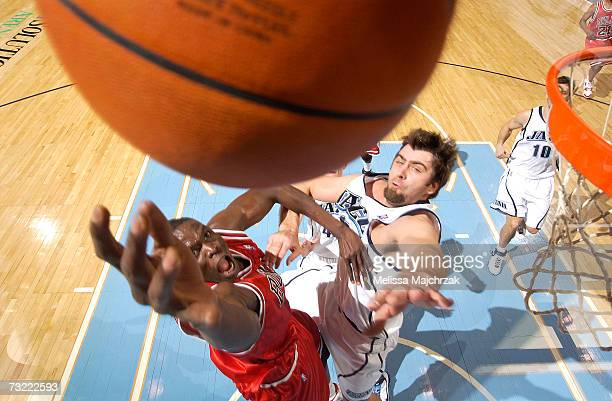 Luol Deng of the Chicago Bulls goes up for the rebound against Mehmet Okur of the Utah Jazz on February 5 2007 at the EnergySolutions Arena in Salt...