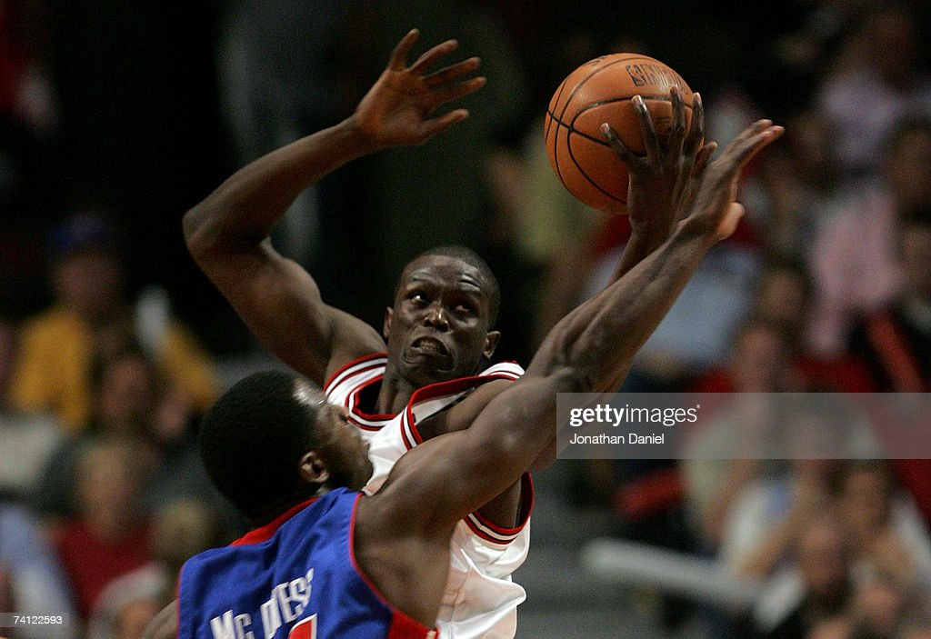 Luol Deng #9 of the Chicago Bulls grabs a rebound against Antonio McDyess #24 of the Detroit Pistons in Game Three of the Eastern Conference Semifinals during the 2007 NBA Playoffs at the United Center Center on May 10, 2007 in Chicago, Illinois.