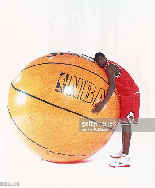 Luol Deng of the Chicago Bulls poses with a gigantic basketball during the 2004 NBA Rookie Photo Shoot at Madison Square Garden Training Facility on...