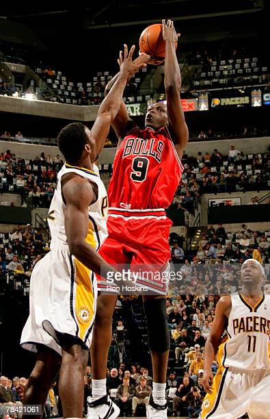 Luol Deng of the Chicago Bulls shoots over Kareem Rush of the Indiana Pacers at Conseco Fieldhouse on December 12, 2007 in Indianapolis, Indiana....