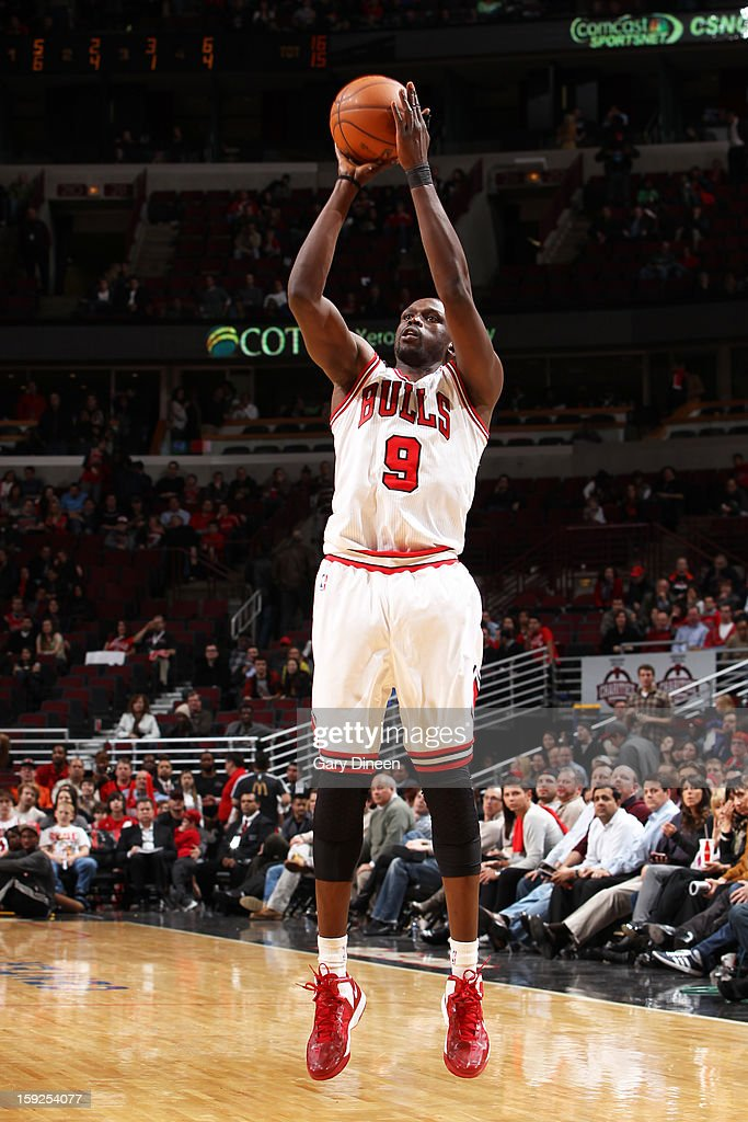 Luol Deng #9 of the Chicago Bulls takes a shot against the Milwaukee Bucks on January 9, 2013 at the United Center in Chicago, Illinois.