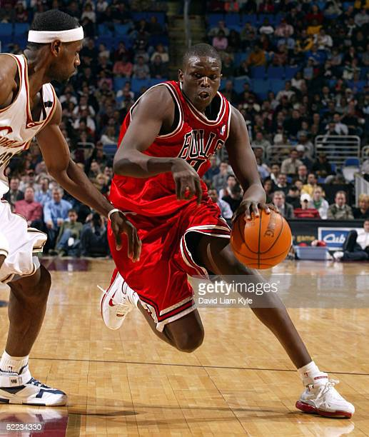 Luol Deng of the Chicago Bulls tries to drive in on LeBron James of the Cleveland Cavaliers on February 23, 2005 at Gund Arena in Cleveland, Ohio....