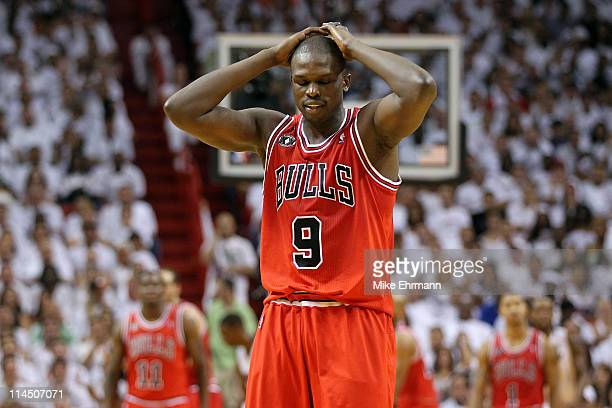 Luol Deng of the Chicago Bulls walks up court with his head down against the Miami Heat in Game Three of the Eastern Conference Finals during the...