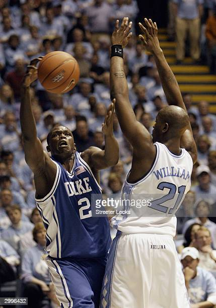 Luol Deng of the Duke Blue Devils grabs the ball as he is covered by Jawad Williams of the University of North Carolina Tar Heels on February 5 2004...