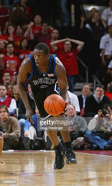 Luol Deng of the Duke Blue Devils moves the ball up court during the game against the Maryland Terrapins on January 21 2004 at the Comcast Center in...