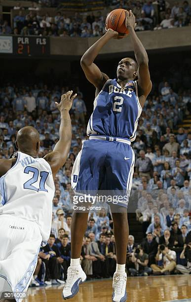 Luol Deng of the Duke Blue Devils shoots a jumper over Jawad Williams of the North Carolina Tar Heels during the game on February 5 2004 at the Dean...