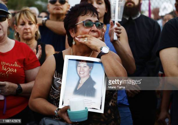 Lupe Lopez carries a photo of Elsa Mendoza Marquez a Mexican schoolteacher from across the border in Ciudad Juarez who was killed in the shooting...