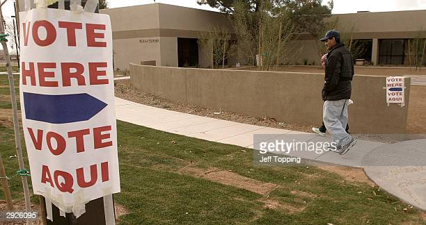 Lupe Montoya and his neighbor Juana Nicholas of El Mirage walk to the El Mirage Youth Center to vote in the Democratic primary February 3 2004 in El...