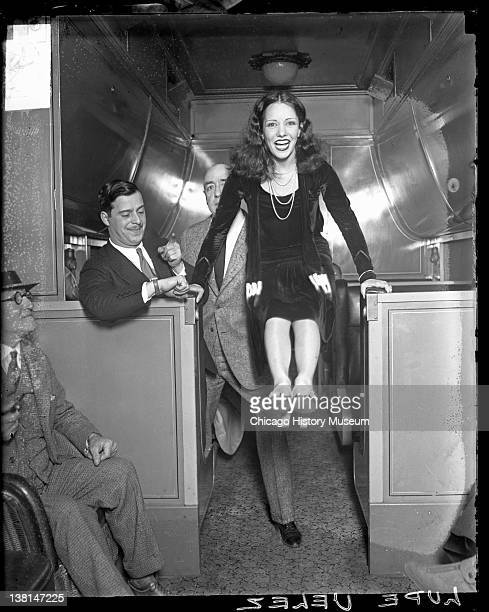 Lupe Velez actress bracing her hands on two low counters Chicago Illinois 1929