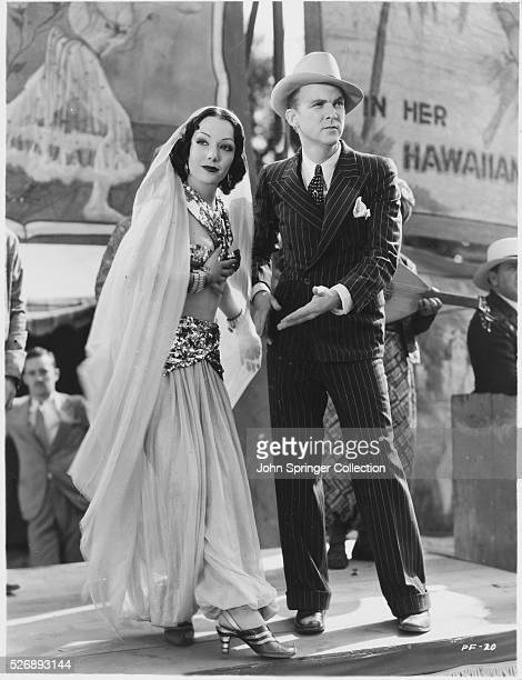 Lupe Velez and Lee Tracy stand on a carnival stage in a scene from the 1932 film The Half Naked Truth Velez plays dancer Teresita aka La Belle...