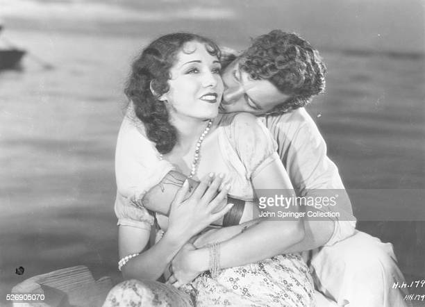 Lupe Velez as Anita Morgan and Jean Hersholt as Joseph Horngold in the 1930 film Hell Harbor