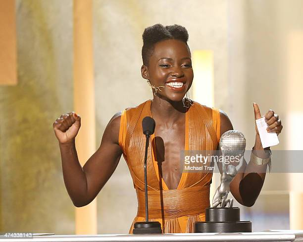 Lupita Nyong'o accepts the award for Outstanding Actress in a Motion Picture for '12 Years a Slave' onstage during the 45th NAACP Image Awards held...