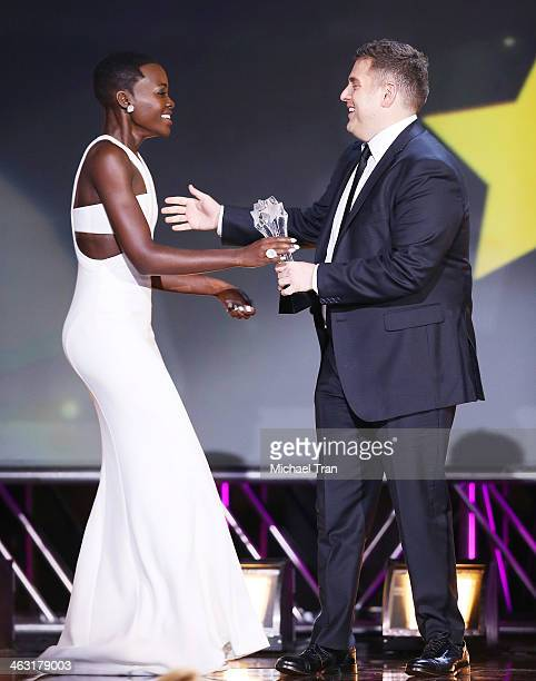 Lupita Nyong'o accepts the Best Supporting Actress award for '12 Years a Slave' from actor Jonah Hill onstage during the 19th Annual Critics' Choice...
