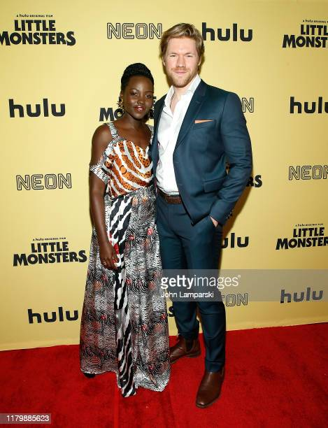 Lupita Nyong'o and Alexander England attend Little Monsters New York premiere at AMC Lincoln Square Theater on October 08 2019 in New York City
